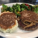 Chopped Steak - <p>Chopped steak topped with gravy; includes your choice of 2 side dishes</p>