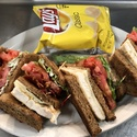 Chicken Club - <p>Traditional triple decker sandwich with grilled chicken, American cheese, bacon, lettuce, tomato &amp; mayo.  Includes one side dish </p>